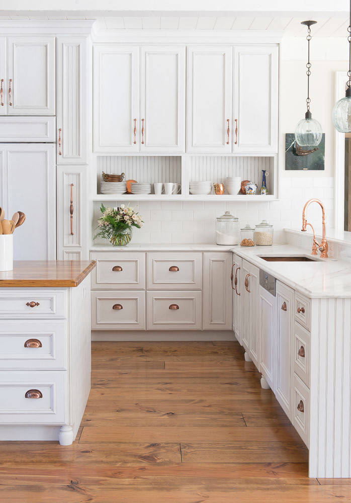 White cabinets with white appliances French Country Kitchen archway glass pendant lights nailhead trim prep kitchen quartzite