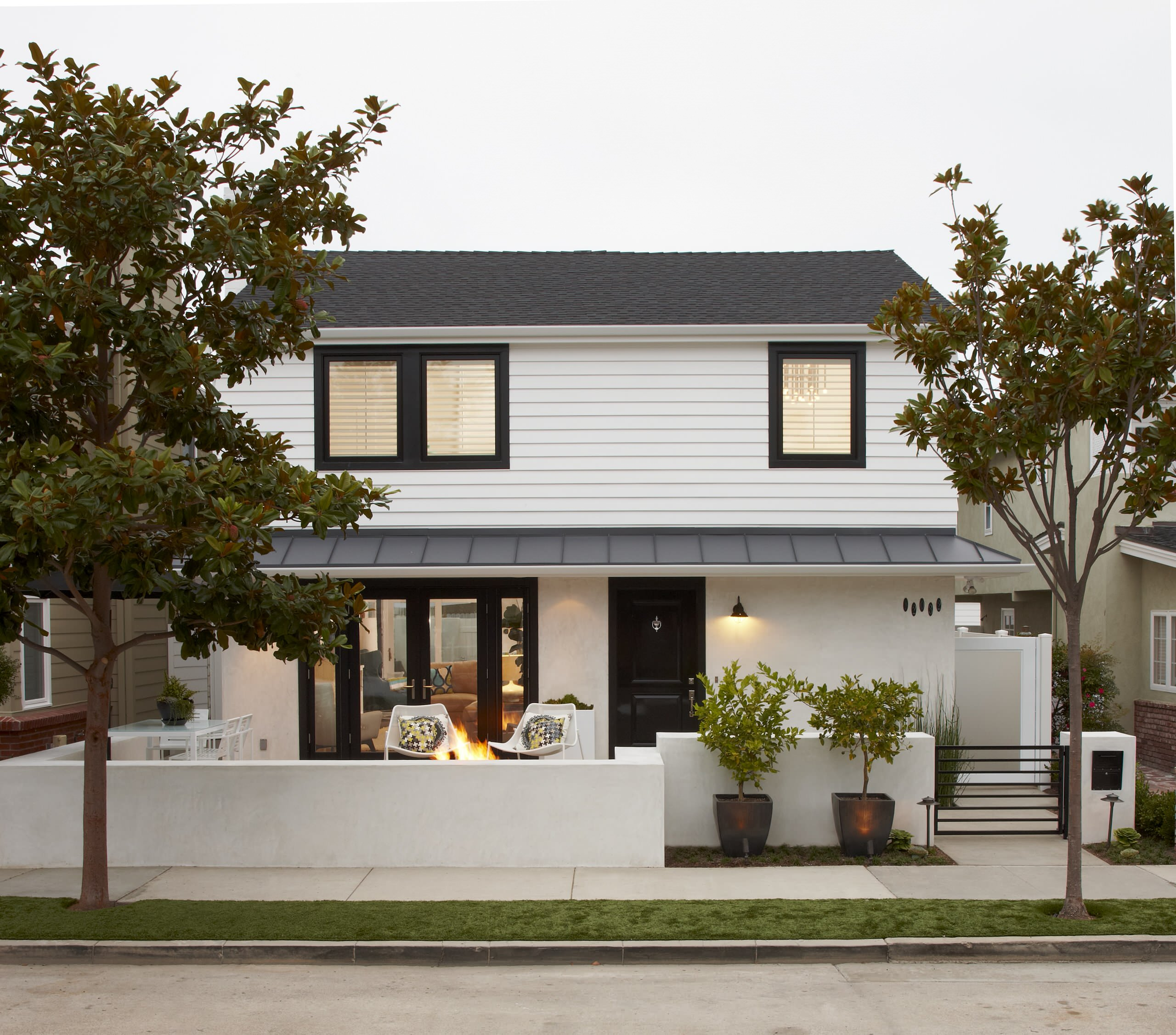 White house black trim Transitional Exterior concrete paving dormer windows entrance front door