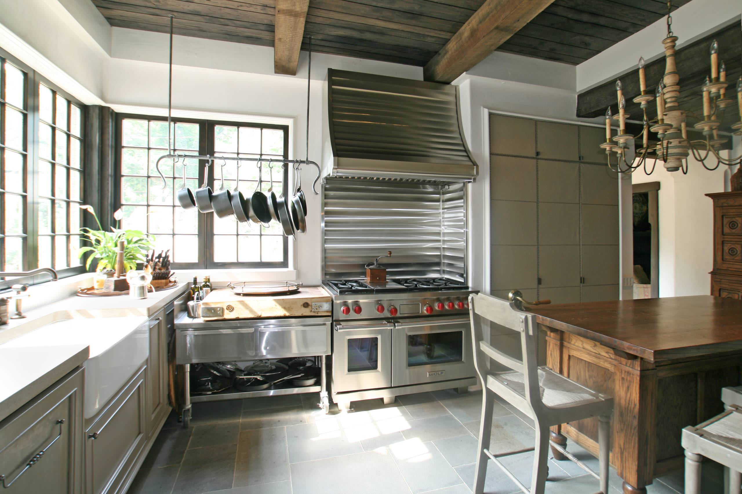 How to clean stainless steel stove Traditional Kitchen breakfast bar bridge faucet butcher block countertops roman shades shaker chairs stainless steel appliances