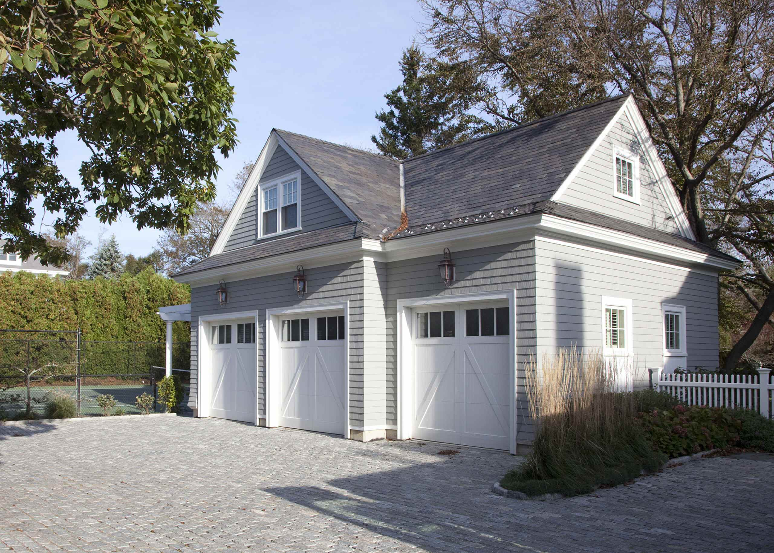 Standard garage door width Traditional Garage carriage doors concrete paving detached garage metal roof wood siding