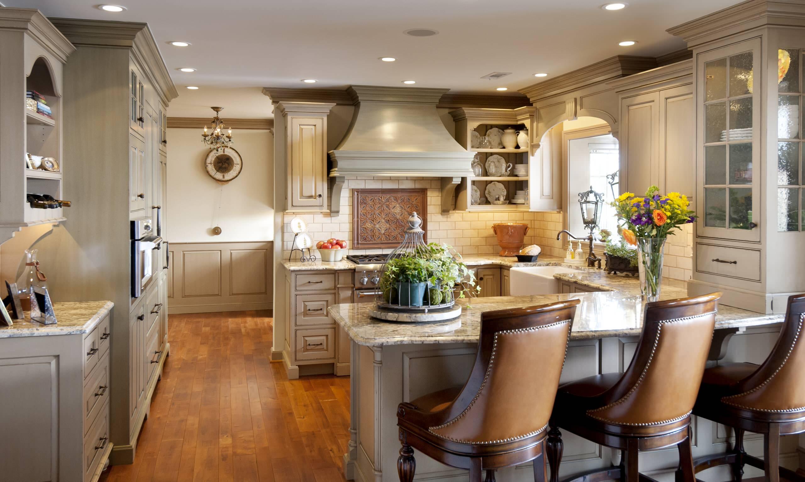 U Shaped Kitchen Designs Traditional Kitchen Beadboard Beige Chandelier Farmhouse Table Pendant Lighting Runner Tile Backsplash White Cabinets Wood Floors